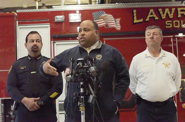 TIM JEAN/Staff photo <br /> <br /> Lawrence mayor Daniel Rivera, center, speaks with members of the media at the Central Fire Station while being joined by Police Chief Roy Vasque, left, and Fire Chief Brian Moriarty as he talks about the Columbia Gas settlement. The parent company of Columbia Gas of Massachusetts will take steps to sell the utility as part of a plea deal to criminal charges stemming from the 2018 gas disaster in the Merrimack Valley.  2/26/20