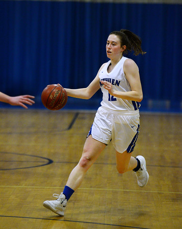 CARL RUSSO/Staff photo Methuen captain, Olivia Barron brings the ball up court. Methuen defeated Somerville 61-47 in girls' basketball action Tuesday night. 2/18/2020..