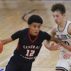 MIKE SPRINGER/Staff photo<br /> Xavier McKenzie of Central Catholic moves the ball past Aiden Callahan of St. John's during varsity basketball action Sunday in Danvers. <br /> 2/2/2020