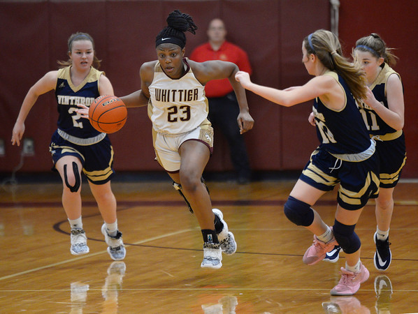CARL RUSSO/Staff Photo Winthrop defenders give chase as Whittier's Grace Efosa-Aguebor steals the ball. Winthrop defeated Whittier Tech. 55-39 in Div. 3 North quarterfinals in girls basketball action Thursday night. 2/27/2020