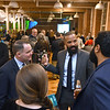 RYAN HUTTON/ Staff photo<br /> Lawrence-based attorney Socrates De La Cruz, second from right, speaks with Ted Priestly, left, of Lawrence Family Healthcare, and Kelly and Jadihel Taveras, foreground, of Esperanza Academy at the GLOW Gala at Everett Mill in Lawrence on Thursday night, November 14, marking the 20th anniversary of Groundwork Lawrence. 11/14/2019