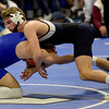 TIM JEAN/Staff photo <br /> <br /> St. John's Prep Rawson Iwanicki, right, takes on Newton South's Adam Bernhardy in the 138 pound match during the MIAA Division 1 wrestling finals at Methuen High School.    2/22/20