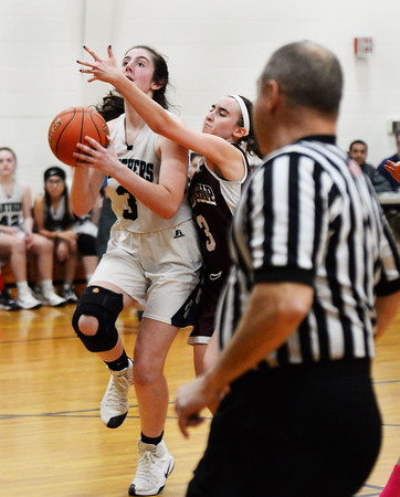 CARL RUSSO/Staff photo Fellowship's Adriana Taboucherani right, plays tight defense as she defends against PMA's Sara D'Agostino. Presentation of Mary Academy defeated Felllowship Christian Academy 51-43 in girls' basketball action Tuesday afternoon. 2/04/2020