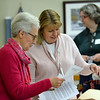 CARL RUSSO/Staff photo. Paula Sable of Newburyport, left receives some information during the Networking Group session from Linda Casale of North Andover, a volunteer at the North Andover Senior Center. The Essex County Regional 50+ Job Seekers Networking Group held their first session on January 14 at the North Andover Senior Center. 1/14/2020