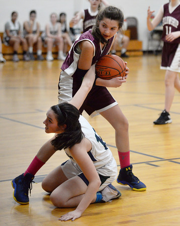 CARL RUSSO/Staff photo PMA's Eva Fabino hits the floor hard with a hand still on the ball as she fights for the bound with Fellowship's Avery Robichaud. Presentation of Mary Academy defeated Felllowship Christian Academy 51-43 in girls' basketball action Tuesday afternoon.  2/04/2020