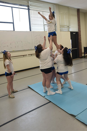 TIM JEAN/Staff photo <br /> <br /> Members of the newly formed cheer squad practice a stunt at Northern Essex Community College. The group meets and practices on the campus in Haverhill.   2/18/20