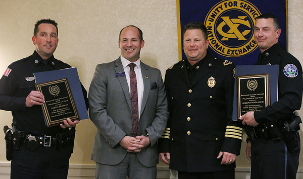 MIKE SPRINGER/Staff photo<br /> Andover police officers Justin Murray, far left, and Joseph Magliozzi, far right, receive the Andover police officer of the year award from Sean Devan, second from left, president of the Exchange Club of Lawrence, and Andover Police Chief Patrick Keefe during the Exchange Club of Lawrence & the Andovers' 58th annual Public Safety Night on Wednesday in Andover.<br /> 2/27/2020