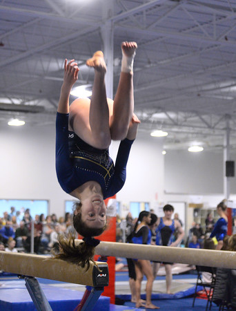 CARL RUSSO/Staff photo The Merrimack Valley Conference Gymnastic League Meet was held Thursday night, February 6th. at A2 Gym and Cheer in Salem NH.  Andover high junior Amanda Morin dismounts off the   balance beam to end her performance.<br /> <br /> Team Score: Chelmsford/Billerica/Tyngsboro 141.45, 2. Central Catholic 139.70, 3. North Andover 138.35, 4. Methuen 137.7, 5. Haverhill 136.85, 6. Andover 132.15, 7. Lowell 130.65, 8. Dracut 130.40, 9. Tewksbury 128.95 2/6/2020<br /> <br /> <br /> <br /> <br /> <br /> <br /> <br /> .