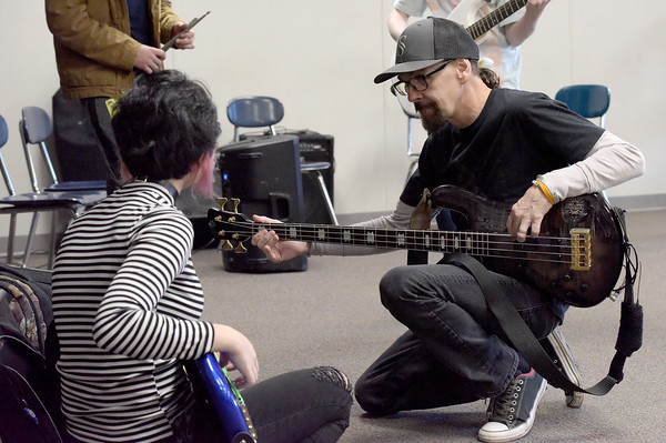 """TIM JEAN/Staff photo <br /> <br /> Godsmack guitar player Robby Merrill, works with Hood Middle School students as they learn part of a song before filming a video for  """"Unforgettable.""""      2/14/20"""