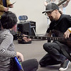 "TIM JEAN/Staff photo <br /> <br /> Godsmack guitar player Robby Merrill, works with Hood Middle School students as they learn part of a song before filming a video for  ""Unforgettable.""      2/14/20"