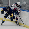 TIM JEAN/Staff photo <br /> <br /> Andover's Tommy Tavenner, left, battles to control the puck with Central's Michael Dinges during a boys hockey game at the ICenter in Salem NH.     2/8/20