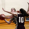 CARL RUSSO/Staff photo PMA's Shannon Colleyer drives to the basket against Fellowship's Chloe Callahan. Presentation of Mary Academy defeated Fellowship Christian Academy 51-43 in girls' basketball action Tuesday afternoon. 2/04/2020