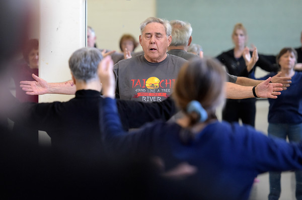 TIM JEAN/Staff photo <br /> <br /> Instructor Allen Drelick, center, leads a class in Tai Chi for seniors at Northern Essex Community College in Haverhill.    2/27/20