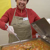TIM JEAN/Staff photo <br /> <br /> Volunteer Marie Greeny, of Londonderry, stirs up her soup during the 15th annual Potter's Bowl fundraiser to benefit Community Caregivers of Greater Derry. The event was held at Pinkerton Academy in Derry, NH.     2/1/20