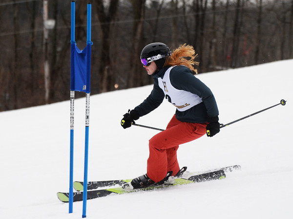 CARL RUSSO/staff photo. Haverhill's Nora Hess, who played field hockey in the fall, skies around the flag. <br /> <br /> Ski teams from Andover, Haverhill and North Andover competed in North Shore Ski League meet on Monday, February 10 at Bradford Ski. 2/10/2020.