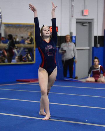 CARL RUSSO/Staff photo Central Catholic sophomore,  Deidre Donovan strikes a pose as she competes in the floor routine. <br /> <br /> The Merrimack Valley Conference Gymnastic League Meet was held Thursday night, February 6, at A2 Gym and Cheer in Salem NH. 2/6/2020.
