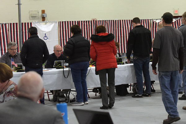 TIM JEAN/Staff photo <br /> <br /> Residents wait in line to pickup ballots before voting at the Londonderry High School during the New Hampshire primary.     2/11/20