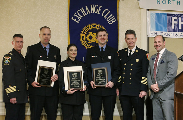 MIKE SPRINGER/Staff photo<br /> North Andover firefighter and police officer of the year awards are presented together during the Exchange Club's 58th annual Public Safety Night on Wednesday in Andover. From left are North Andover Police Chief Patrick Keefe, Firefighter Nicholas Martone, Police Officer Julie Nigro, Firefighter Corey Pramas, North Andover Fire Chief William McCarthy and Exchange Club of Lawrence President Sean Devan.<br /> 2/27/2020