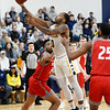 CARL RUSSO/Staff photo. Merrimack's Juvaris Hayes drives to the basket. Merrimack College defeated Sacred Heart 64-57 in men's basketball action. 2/21/2020