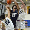 CARL RUSSO/Staff photo Andover's Zayn Aruri, left and Aidan Cammann double team against Lawrence captain Gabriel Zorrilla's lay up. Andover defeated Lawrence 66-57 in boys basketball action Friday night. 2/14/2020.