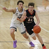 MIKE SPRINGER/Staff photo<br /> Central Catholic's Nate Godin moves the ball upcourt under defensive pressure from Matthew Duchemin of St. John's during varsity basketball action Sunday in Danvers. <br /> 2/2/2020