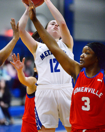 CARL RUSSO/Staff photo Methuen captain, Olivia Barron drives to the hoop for the basket. Methuen defeated Somerville 61-47 in girls' basketball action Tuesday night. 2/18/2020.