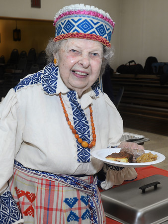 CARL RUSSO/Staff photo Amelia Stundzia of Lawrence, a young 96, always dresses in a traditional Lithuanian outfit when celebrating. Amelia treats herself to a traditional Lithuanian Sausage dinner. <br /> <br /> The Lithuanian American Council and The Knights of Lithuania, Council 78 celebrated its annual Independence celebration on Sunday, February 16. The celebration began with a mass at Corpus Christi Parish at Holy Rosary Church in Lawrence followed by a Lithuanian sausage dinner and entertainment at the parish center. 2/16/2020