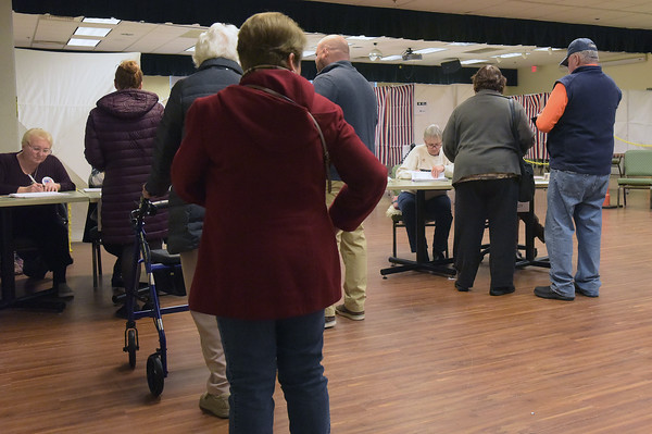 TIM JEAN/Staff photo <br /> <br /> Residents wait in line to pickup ballots at the Ingram Senior Center before voting during the New Hampshire primary in Salem.     2/11/20