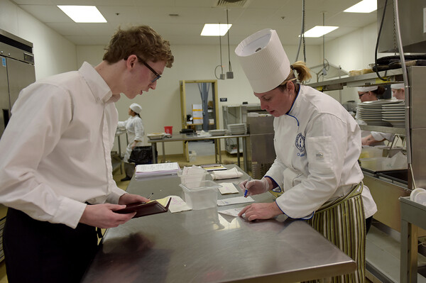 TIM JEAN/Staff photo <br /> <br /> Student Markus Huber, left, of Rockport talks with Chef Kristine Kelley in the kitchen of the student-run Beacon Cafe at North Shore Community College's Middleton campus.    1/30/20