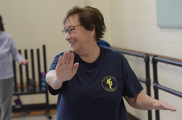 TIM JEAN/Staff photo <br /> <br /> Fran Walter, of Haverhill, looks toward instructor Allen Drelick, as he leads a class in Tai Chi for seniors at Northern Essex Community College in Haverhill.    2/27/20