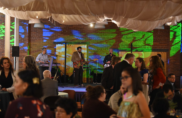RYAN HUTTON/ Staff photo<br /> The band Los Sugar Kings perform at the GLOW Gala at Everett Mill in Lawrence on Thursday night, November 14 marking the 20th anniversary of Groundwork Lawrence. 11/14/2019