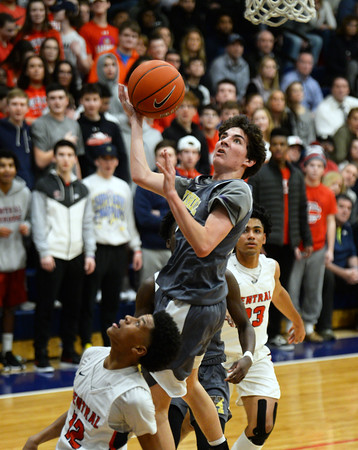 CARL RUSSO/Staff photo. Haverhill's Zachary Guertin drives to the basket. Central Catholic defeated Haverhill in boys basketball in D1 North opener Monday night.  2/24/2020.