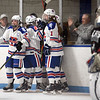 CARL RUSSO/Staff Photo Methuen/Tewksbury's captain Ryan Quinn, left and her teammates celebrate after Lydia Pendleton scores the first goal of the game. Methuen/Tewksbury defeated Longmeadow in OT 2-1 girls hockey tournament opener. 2/26/2020.