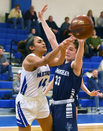 CARL RUSSO/staff photo. Methuen's Yarmilis Vasquez passes the ball to a teammate breaking towards the basket. Methuen Rangers defeated Framingham in girls' basketball action Sunday afternoon. 2/9/2020.