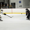 CARL RUSSO/Staff photo North Andover's goalie, Patrick Green makes the save on Haverhill's Evan Foskett's break away. North Andover defeated Haverhill 6-2 in boys' hockey action. 2/05/2020