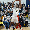 CARL RUSSO/Staff photo. Merrimack's Mykel Derring <br /> sails to the basket. Merrimack College defeated Sacred Heart 64-57 in men's basketball action. 2/21/2020.