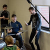 "TIM JEAN/Staff photo <br /> <br /> Godsmack drummer Shannon Larkin, right, works with  Hood Middle School student Rui Hernandez, seated as students learn part of a song before filming a video for  ""Unforgettable.""      2/14/20"