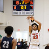 CARL RUSSO/Staff photo Central's Marcus Rivera takes the three point jump shot. Central Catholic played against Lawrence in boys basketball action Tuesday night. 2/11/2020.