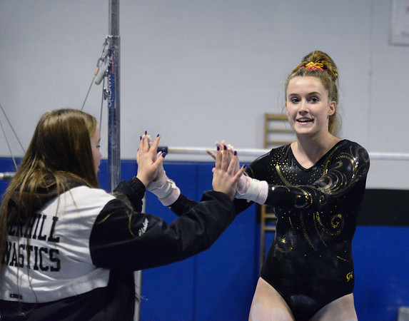 """CARL RUSSO/Staff photo Haverhill's Maren Eramo, right is congratulated after her performance on the bars. <br /> She captured second place in the all around in the <br /> Merrimack Valley Conference Gymnastic League Meet Thursday night on February 6, held at A2 Gym and Cheer in Salem NH. <br /> <br /> """"Maren did great medaling in every event,"""" said Haverhill coach Melanie Tarbox. """"Our league is strong. We had several personal bests in individual events, and a few girls really break through.  2/6/2020"""