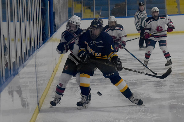 TIM JEAN/Staff photo <br /> <br /> Andover's Anthony Private, right, checks Central's Andrew Flammia into the boards during a boys hockey game at the ICenter in Salem NH.     2/8/20