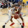 CARL RUSSO/Staff photo. Merrimack's Juvaris Hayes controls the ball against Sacred Heart's Tyler Thomas. Merrimack College defeated Sacred Heart 64-57 in men's basketball action. 2/21/20200.