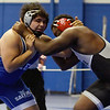 TIM JEAN/Staff photo <br /> <br /> Salem's Josh Ozoria, left, wrestles against Xavier Ct., Malcolm Wilson in the 285 pound match during the Methuen Invitational.  Ozoria won 5-4 for 3rd in the finals.   2/1/20