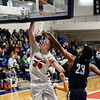 CARL RUSSO/Staff photo Central's captain, Anthony Traficante drives to the basket against Lawrence's captain, Gabriel Zorrilla. Central Catholic played against Lawrence in boys basketball action Tuesday night. 2/11/2020.