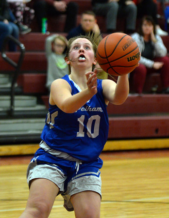CARL RUSSO/Staff photo Pelham's Abby McFarland keeps her eye on the hoop as she goes up for the lay up. Pelham defeated Timberlane 52-21 in girls' basketball action Monday night. 2/17/2020.