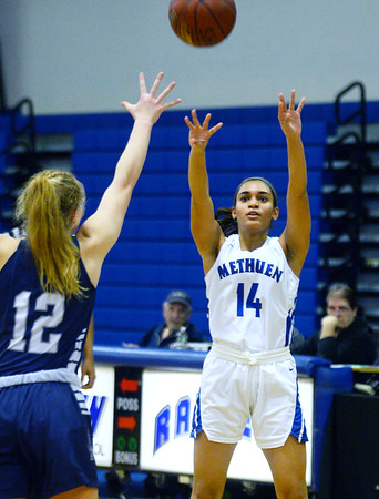 CARL RUSSO/staff photo. Methuen's Yarmilis Vasquez takes the three point jump shot. Methuen Rangers defeated Framingham in girls' basketball action Sunday afternoon. 2/9/2020.