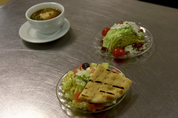 TIM JEAN/Staff photo <br /> <br /> For starters a Greek Salad, made with Kalamata olives, tomatoes, cucumbers, feta cheese and creamy Caesar dressing. Wedge Salad, and French Onion Soup made for a customer in the student-run Beacon Cafe at North Shore Community College's Middleton campus.    1/30/20