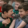 MIKE SPRINGER/Staff photo<br /> Second-graders Troy Gomez, left, and Riley Farrell laugh together during a surprise moment during a Museum of Science presentation Tuesday at Derry Village Elementary School.<br /> 2/18/2020
