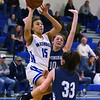 CARL RUSSO/staff photo. Methuen's Mirelys Morales is fouled as she drives to the basket. Methuen Rangers defeated Framingham in girls' basketball action Sunday afternoon.  2/9/2020.