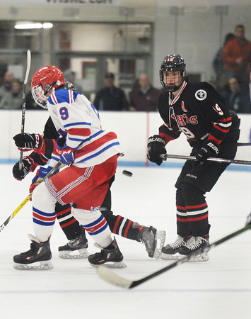 CARL RUSSO/Staff photo North Andover's T.J. Fredo keeps his eye on the flying puck. North Andover defeated Tewksbury 3-2 in Div. 2 hockey quarterfinals at the Chelmsford Forum Friday night. 2/28/2020