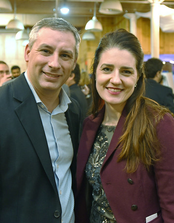 RYAN HUTTON/ Staff photo<br /> Chris Hunt, left, and Elin Anderson, right, of the Professional Center for Child Development at the GLOW Gala at Everett Mill in Lawrence on Thursday night, November 14 marking the 20th anniversary of Groundwork Lawrence. 11/14/2019